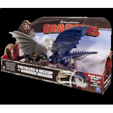 Беззубик и Иккинг против синего дракона в брони